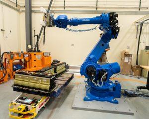 Robot demonstrating battery pack diassembly